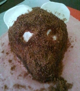 I covered the bear in a dark coloured icing and sugar which I coloured brown.