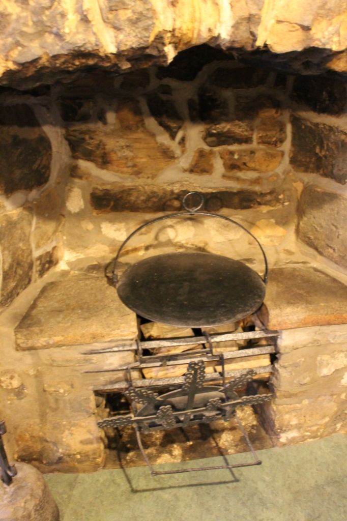 A small fireplace and griddle.