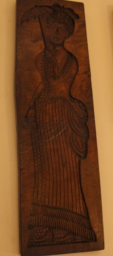 The biscuit type of gingerbread is often shaped using detailed moulds, such as this one which I saw Volkskunde (Folklore) Museum in Bruges, Belgium. This mould is unusual however because of its scale, it is at least a metre tall!